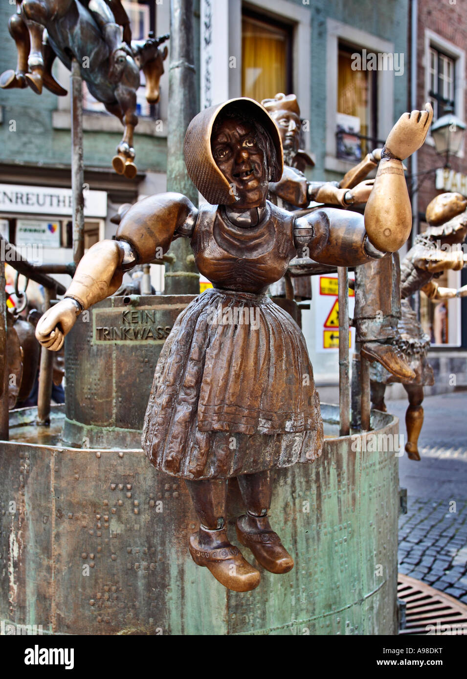 Aachen, Germany - Puppenbrunnen fountain statue - public art - Stock Image