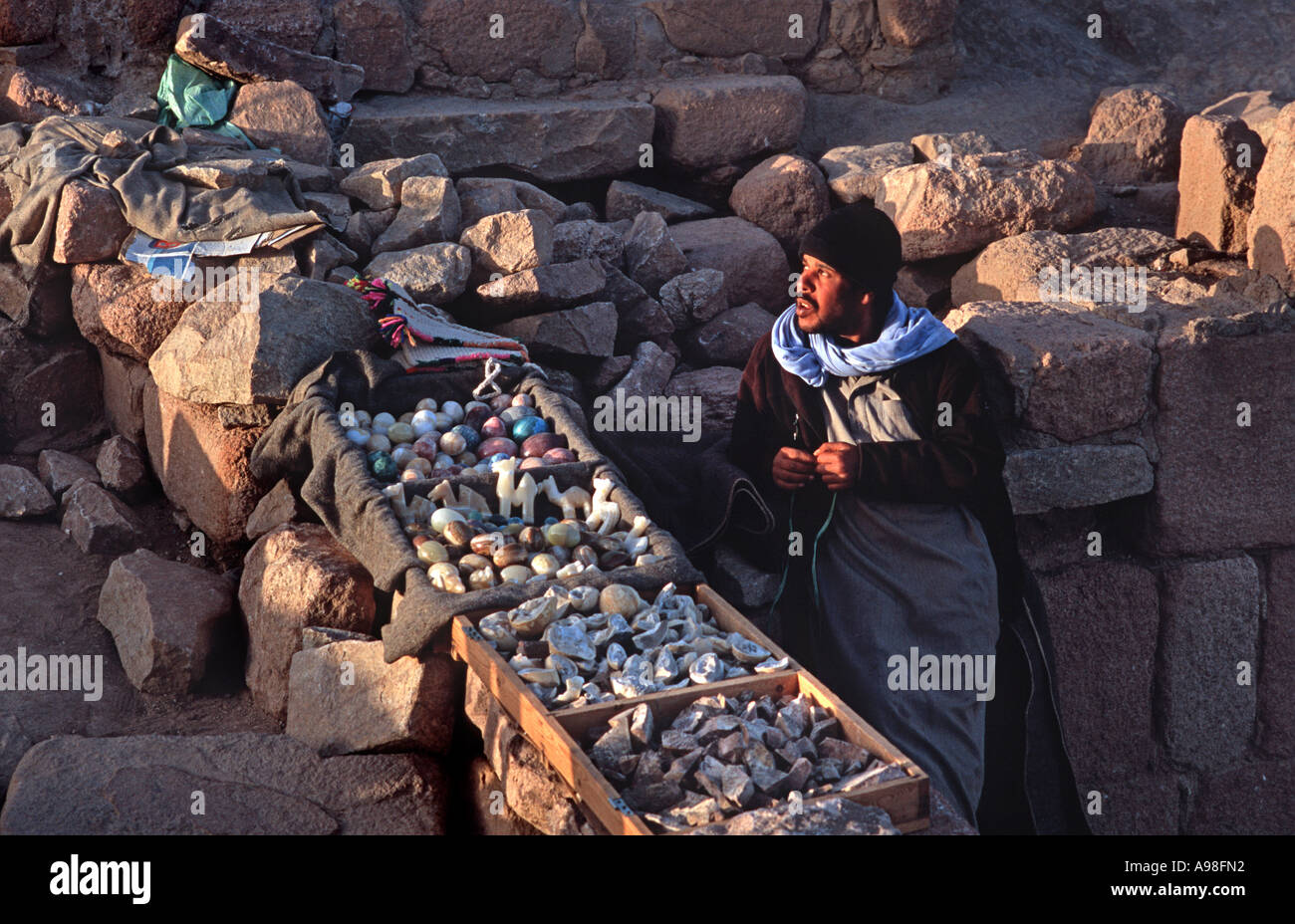 Bedouin vendor selling from his stall on the summit of Mount Sinai 'holy land' Sinai Egypt - Stock Image