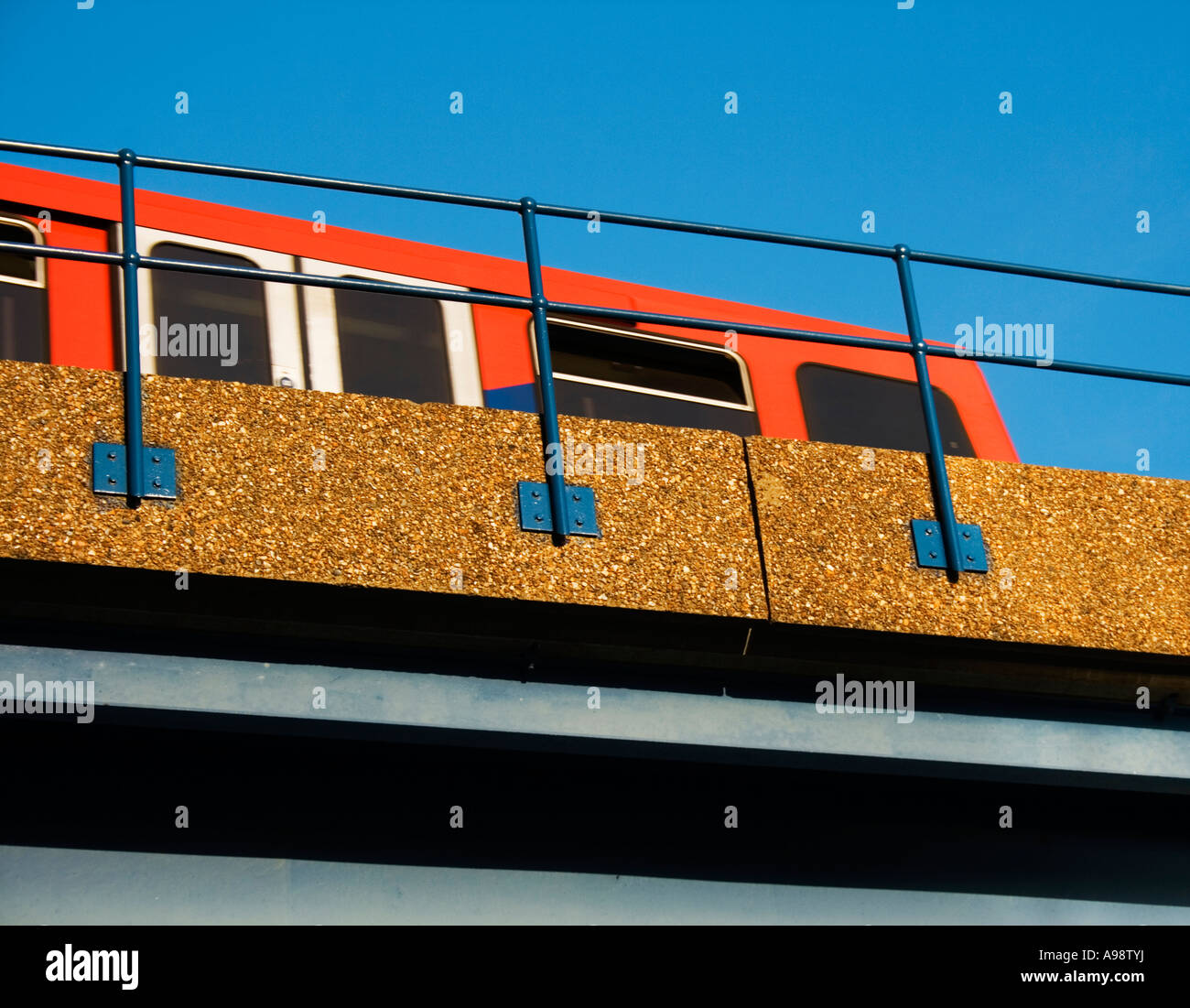 DLR ON BRIDGE detail, creating an almost graphic image as the train moves towards  Canary Wharf station, in London's - Stock Image