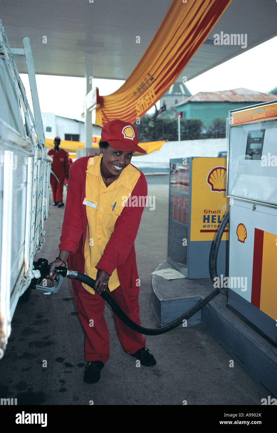 Girl serving diesel at Shell Garage Addis Ababa Ethiopia - Stock Image