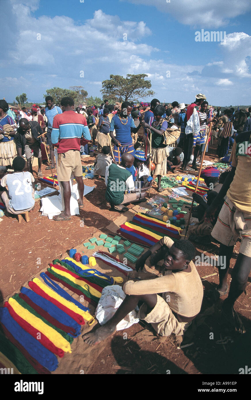 Busy market selling threads for traditional colourful clothes Konso Ethiopia - Stock Image