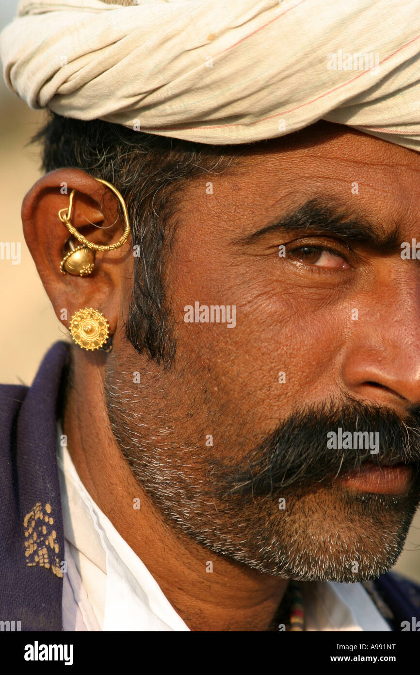 Famous Gujarati Tribal man wearing typical mix of gold earrings Stock  ND04