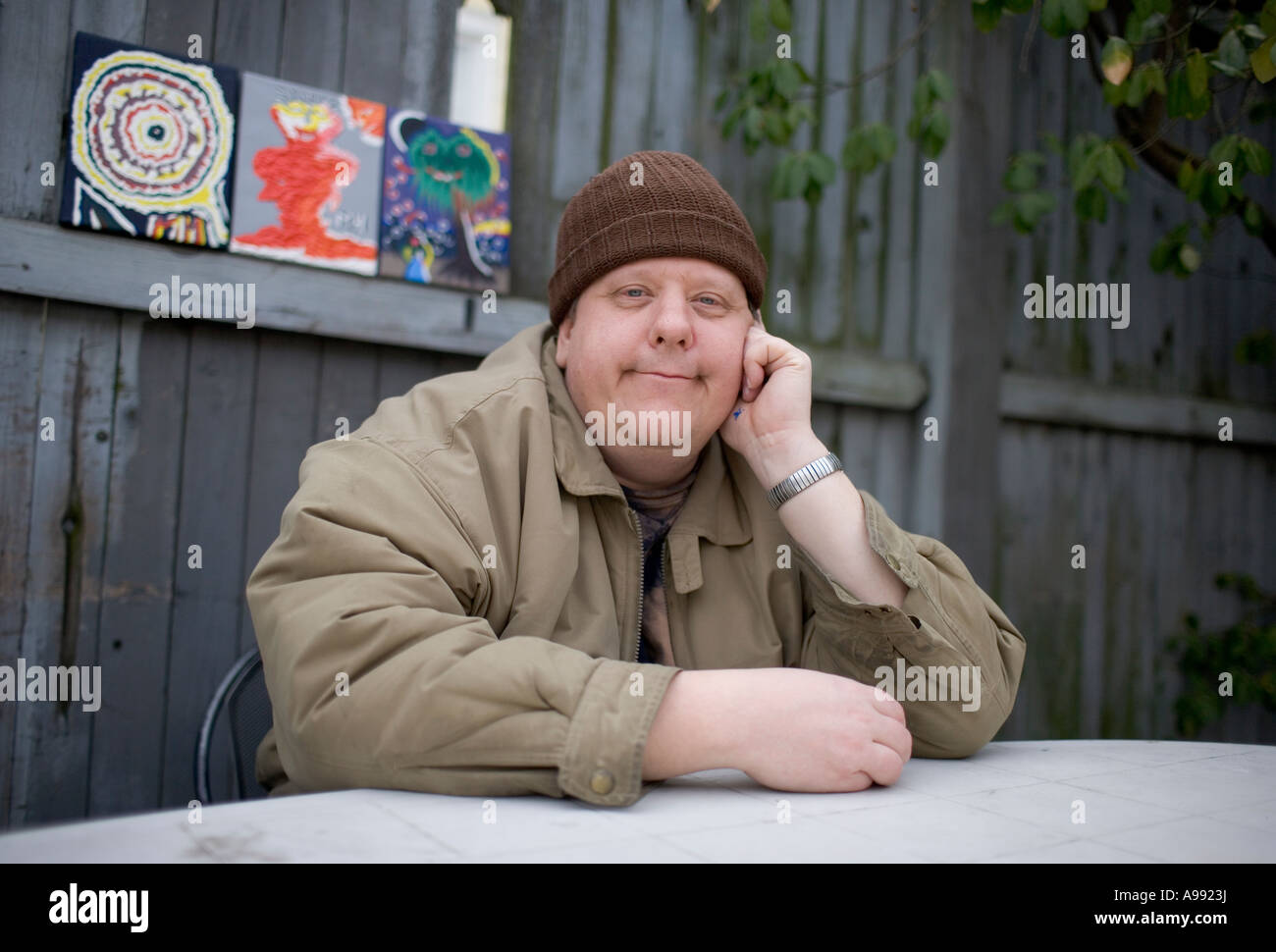 A man with Mental Health Issues who is an artist and is participating in an art exhibit - Stock Image