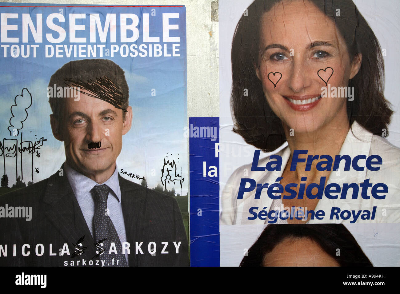Nicolas Sarkozy and Segolene Royal for presidential election posters 2007. Sarkozy is seen as Hitler with moustache Stock Photo