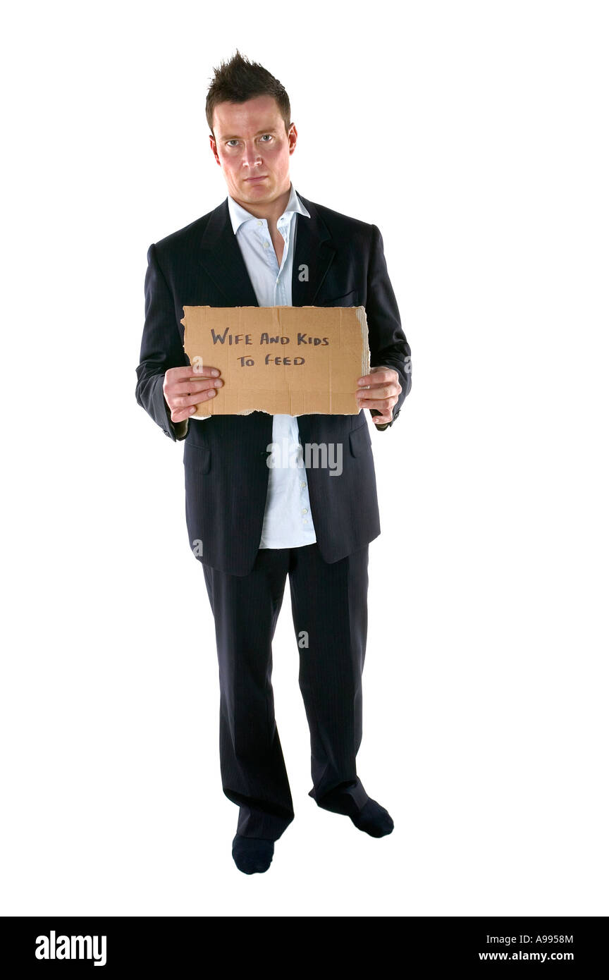 Businessman looking untidy holding a wife and kids to feed sign - Stock Image