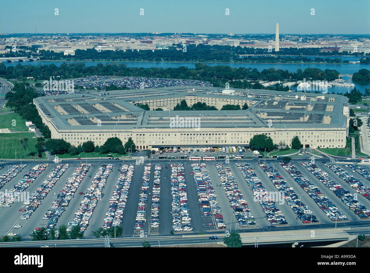 Oblique aerial view of the Pentagon and its vast parking lots Washington DC lies beyond behind the Potomac River - Stock Image