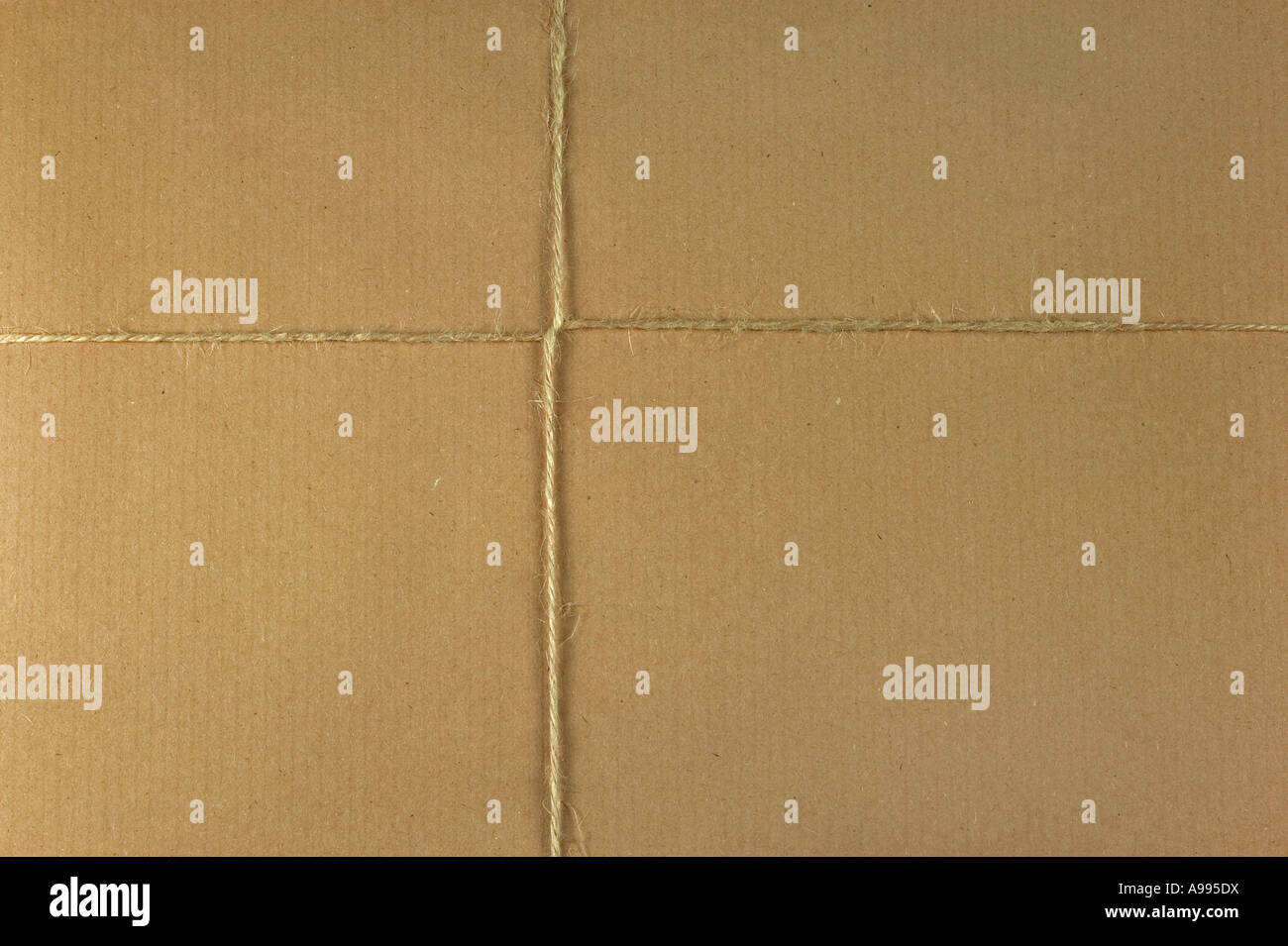 Brown parcel and string background space for copy Stock Photo