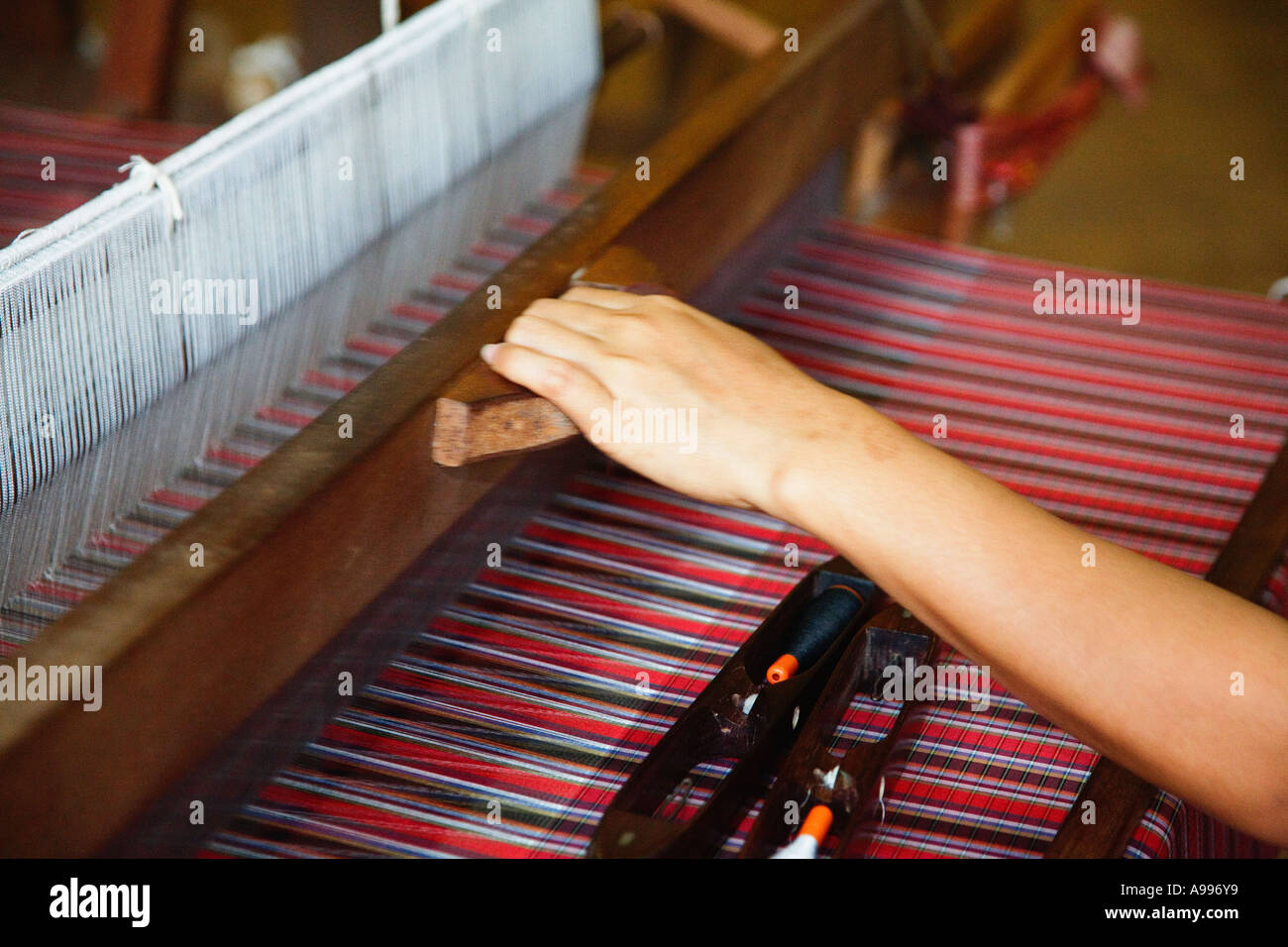 Silk production on an upright loom in a silk factory in Bo Sang Bo Sang is in northeast Thailand the center of silk - Stock Image