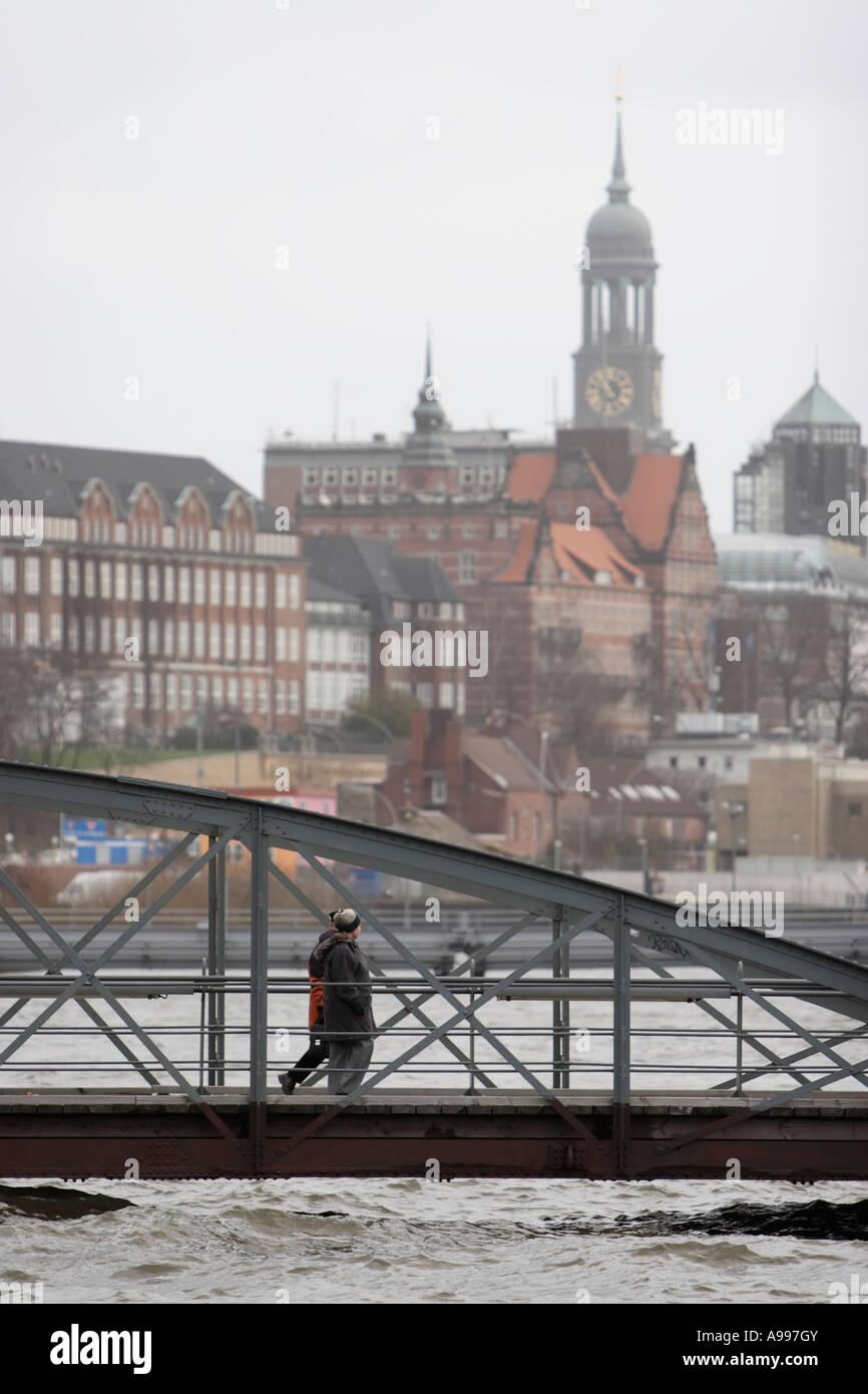 Germany, January 13, 2007. Pedestrians walk on a bridge past floods at traditional fish market area Fischmarkt in Hamburg Stock Photo
