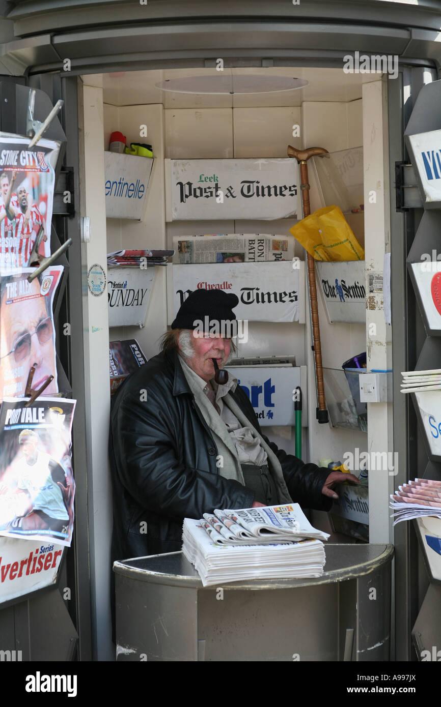 A newspaper seller in Hanley, Stoke on Trent. - Stock Image