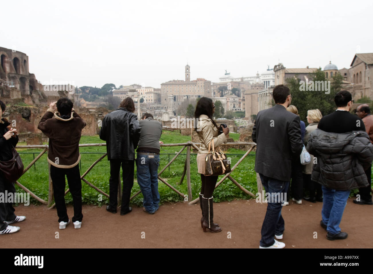 Tourists take pictures at Forum Romanum in Rom, Italy - Stock Image