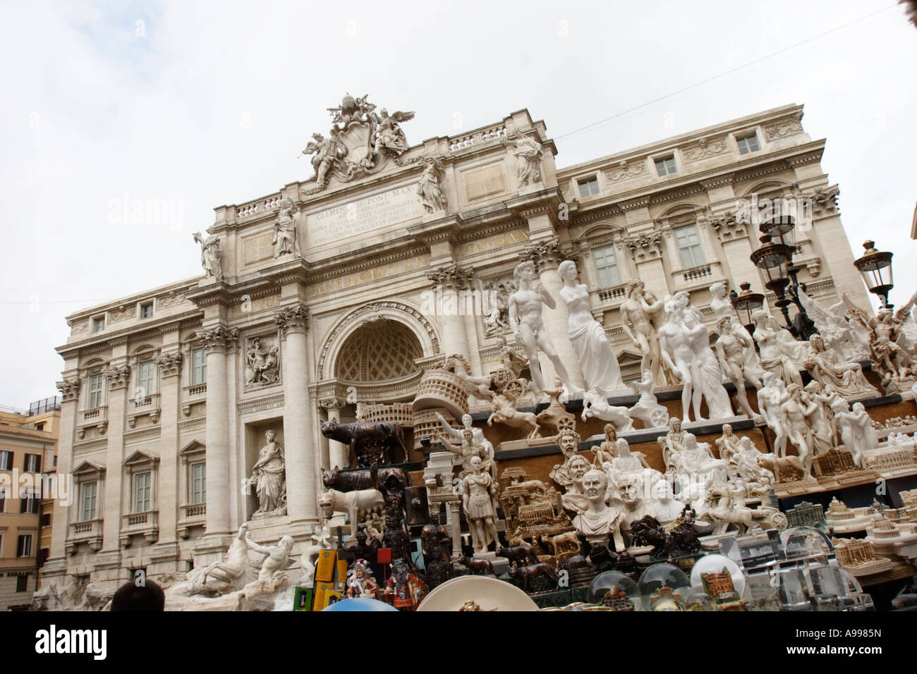 The Trevi Fountain viewed over a souvenir stall in Rome, Italy Stock Photo