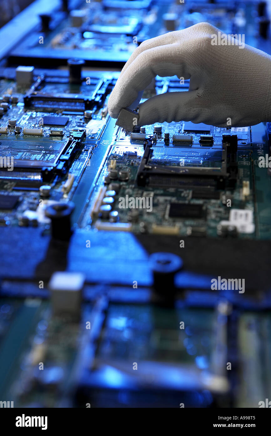Manual Hand Placed Components Printed Circuit Board Manufacturing Completely Assembled View Along Assembly Belt