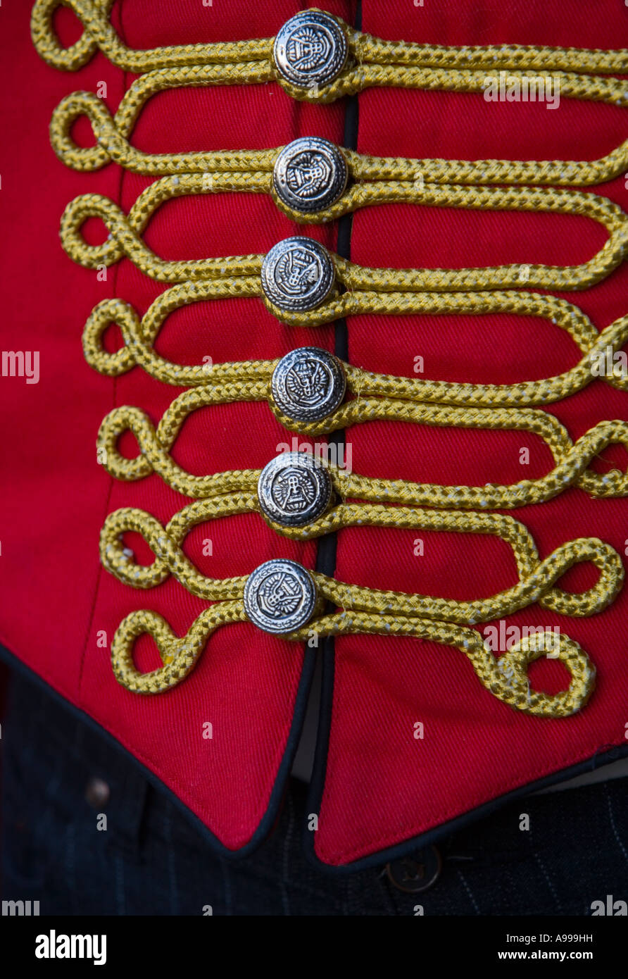 Bright red uniform with gold braid in shop in Camden Market, London - Stock Image