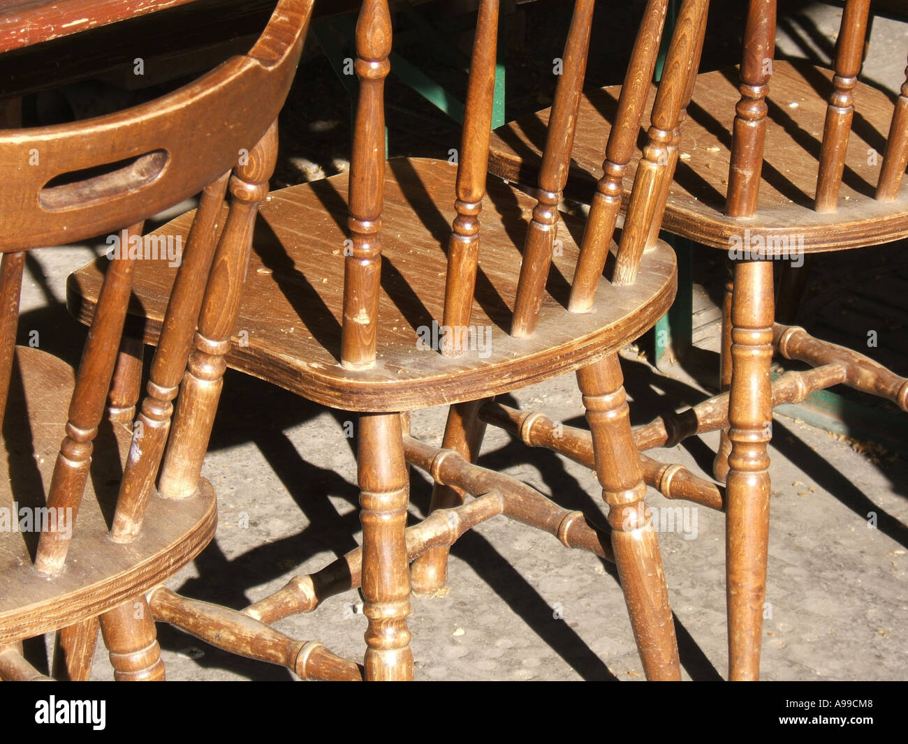 Old Fashioned Wooden Chairs By Table Stock Photo 7025223 Alamy
