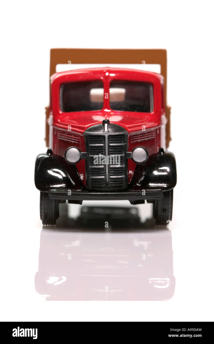 Front view of a model old fashioned delivery truck isolated on white - Stock Image