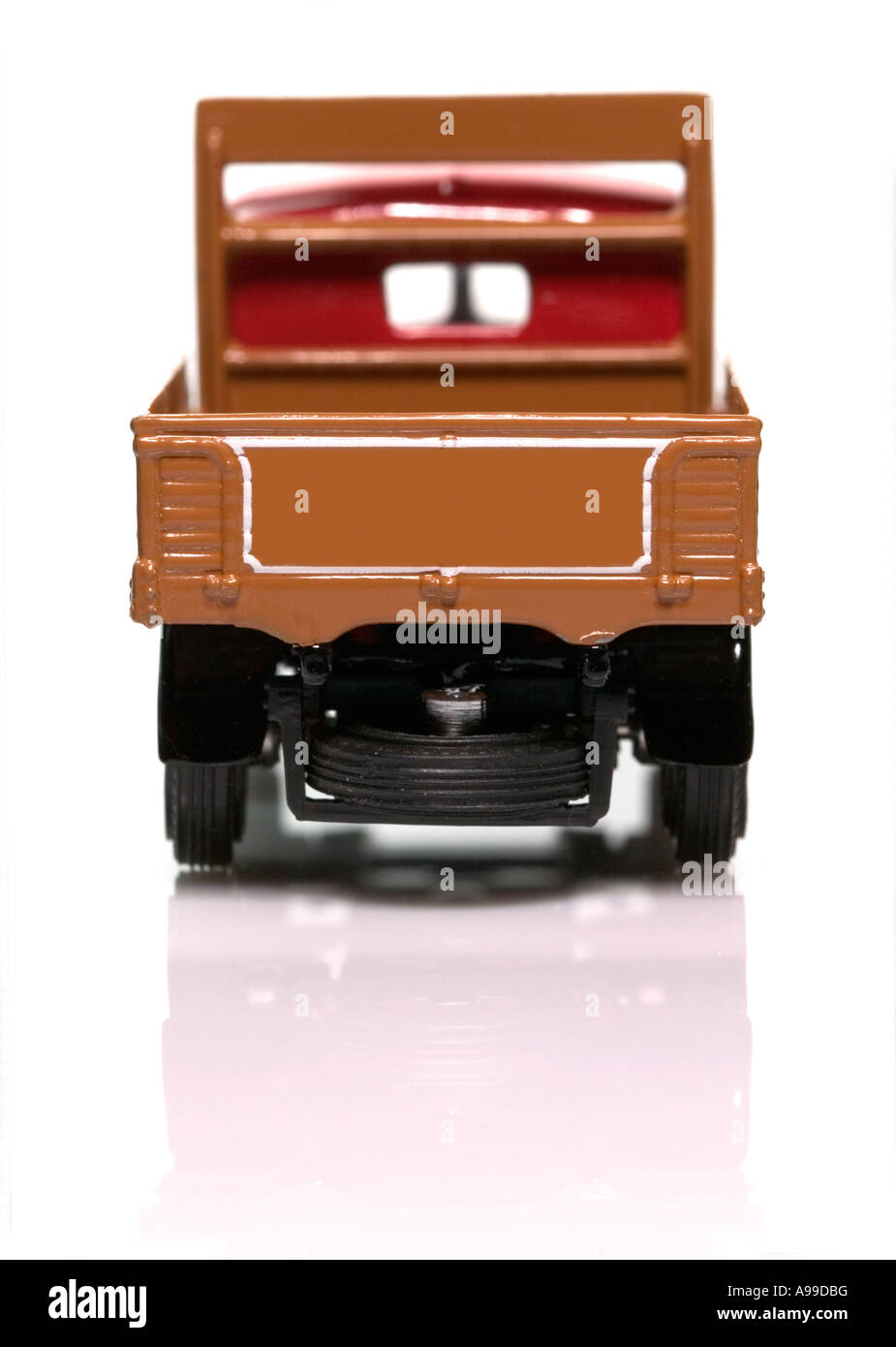 Rear view of a model old fashioned delivery truck isolated on white - Stock Image