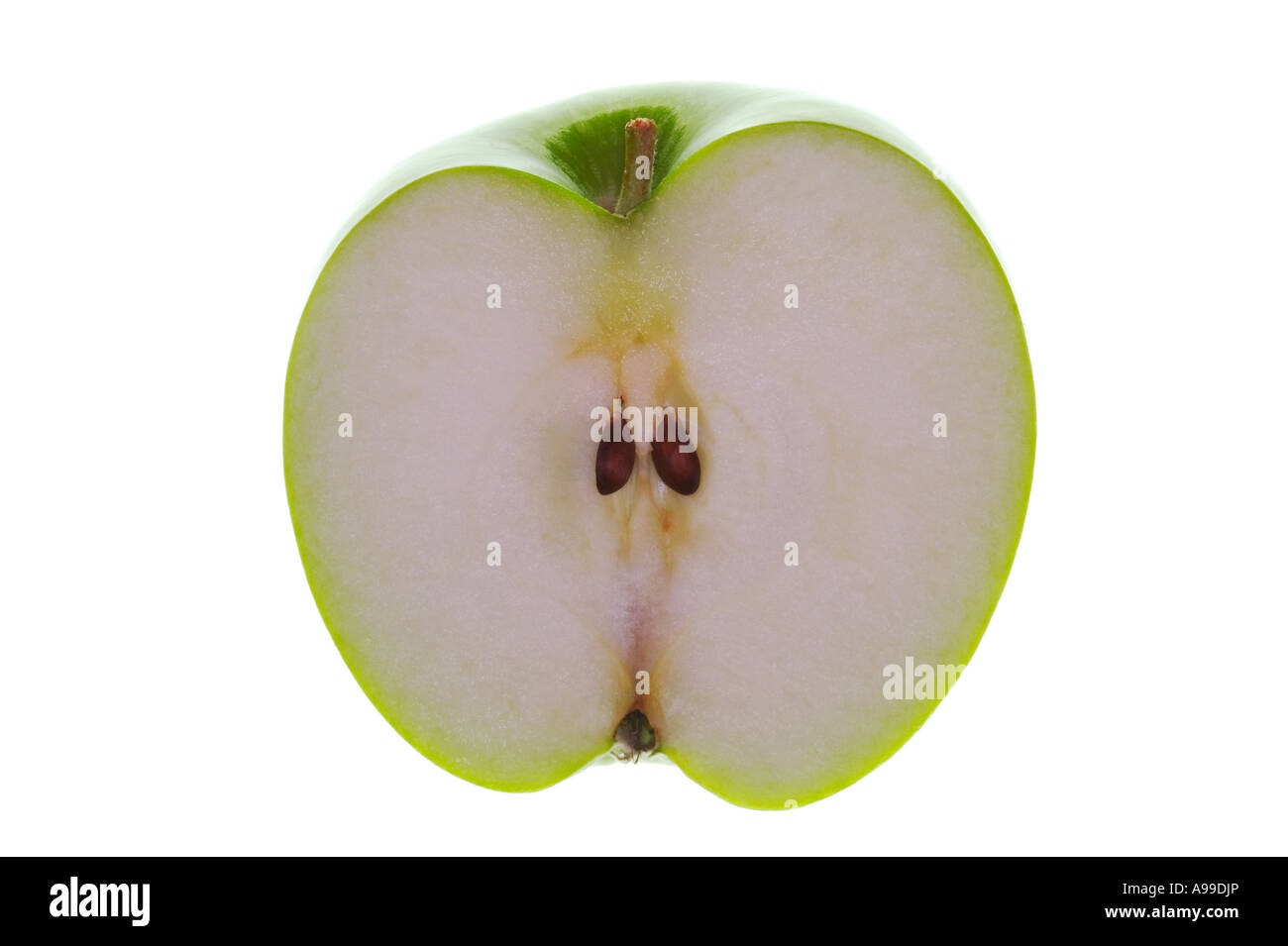 Half a green Apple Backlit and isolated on white - Stock Image