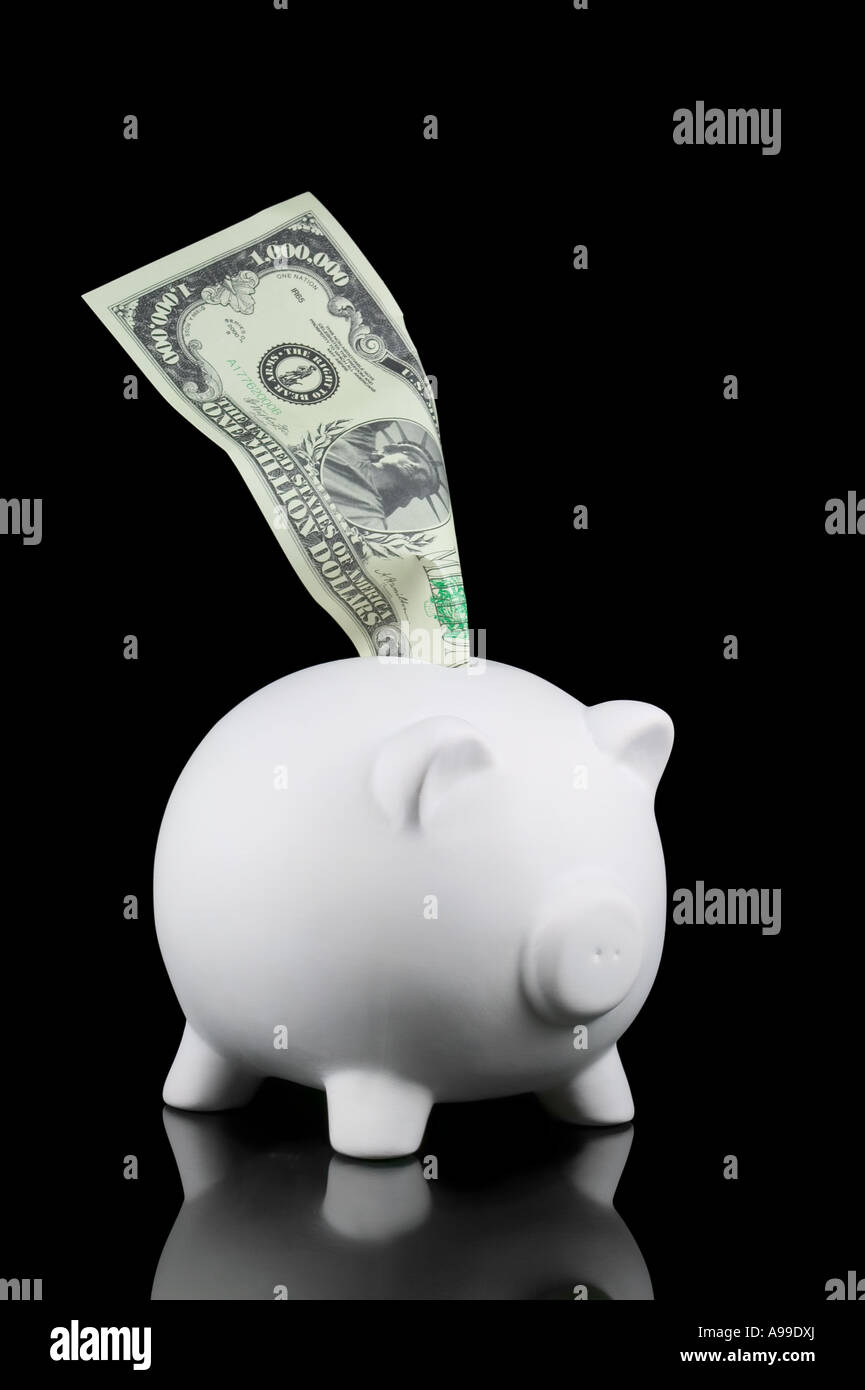 Piggy bank with a Million Dollar note isolated on black - Stock Image
