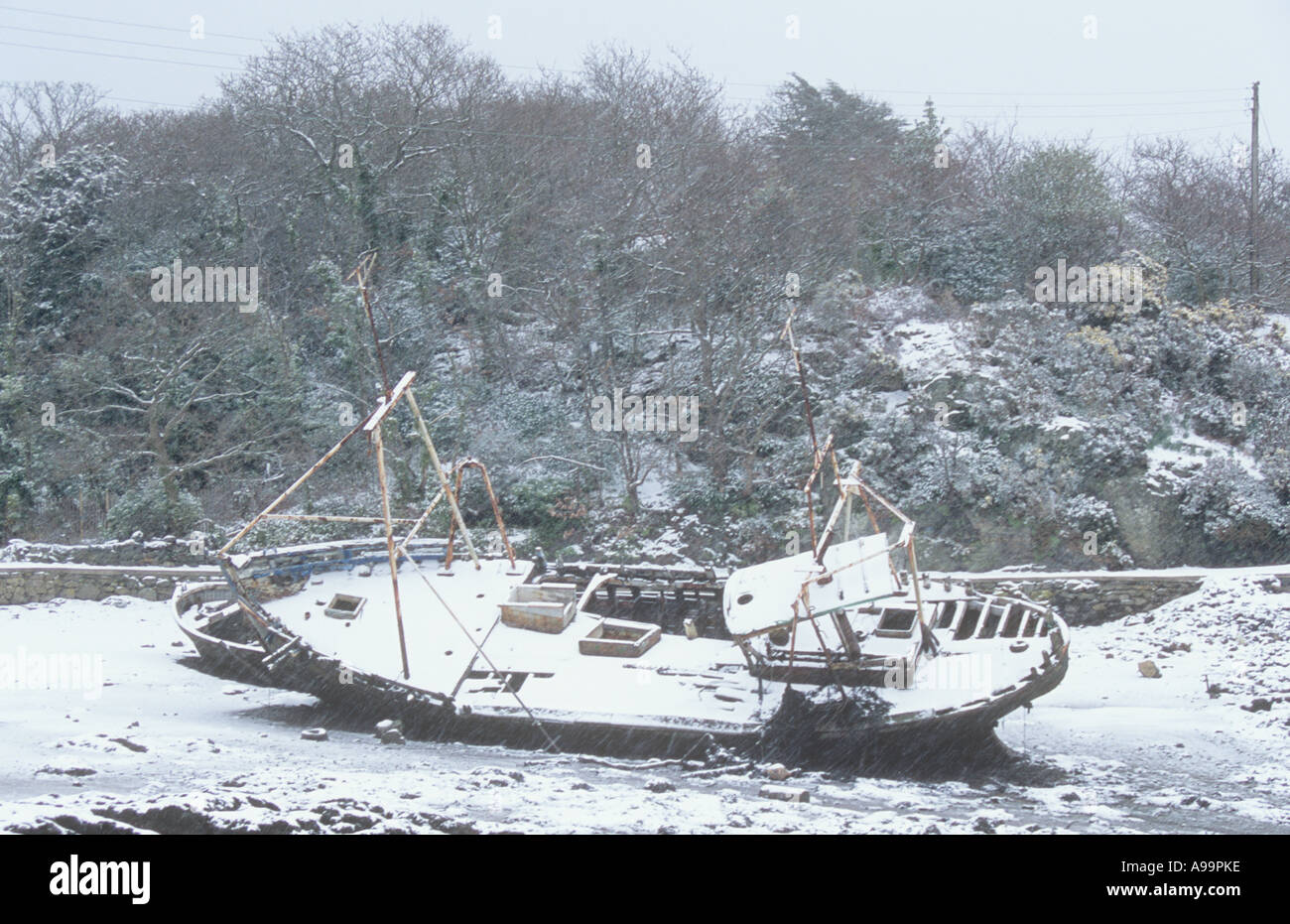 Shipwreck in the snow - Stock Image