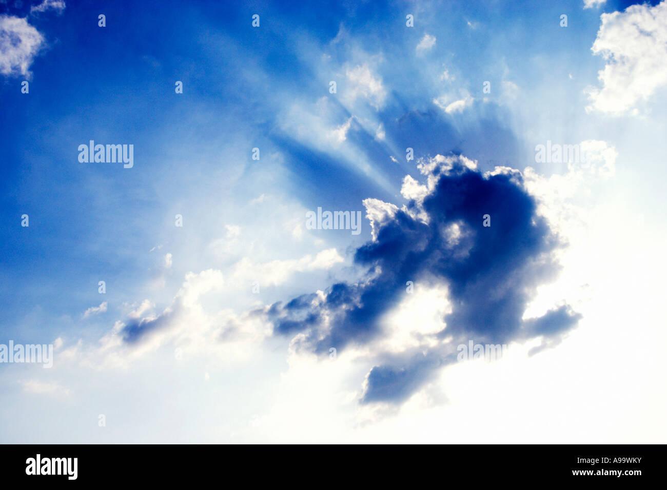 Sunburst through cloud-scape. - Stock Image