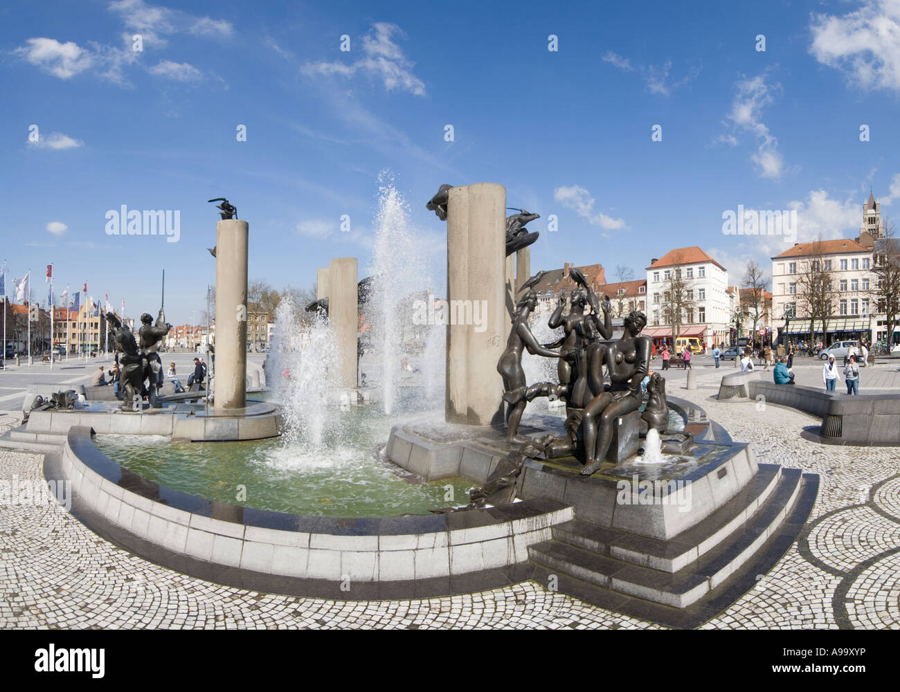 A 2 picture stitch panoramic of the modern sculptures and fountains that occupy T' Zand square in Bruges (Brugge), - Stock Image