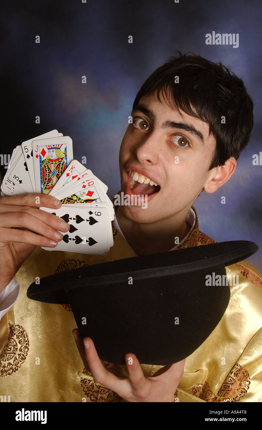 A young magician on stage - Stock Image