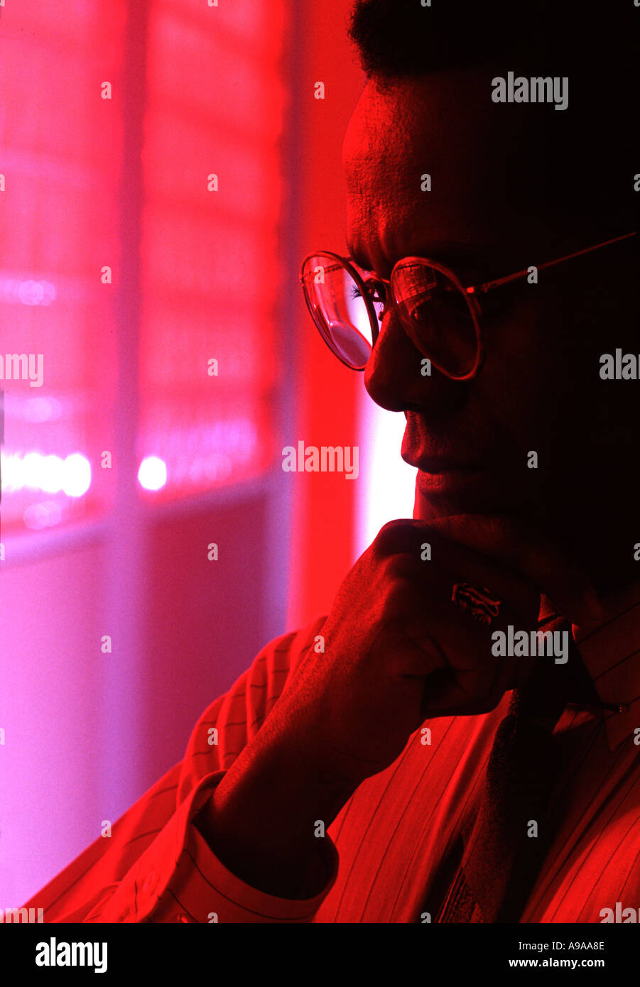 Research Scientist Pondering Problem in Laboratory Stock Photo