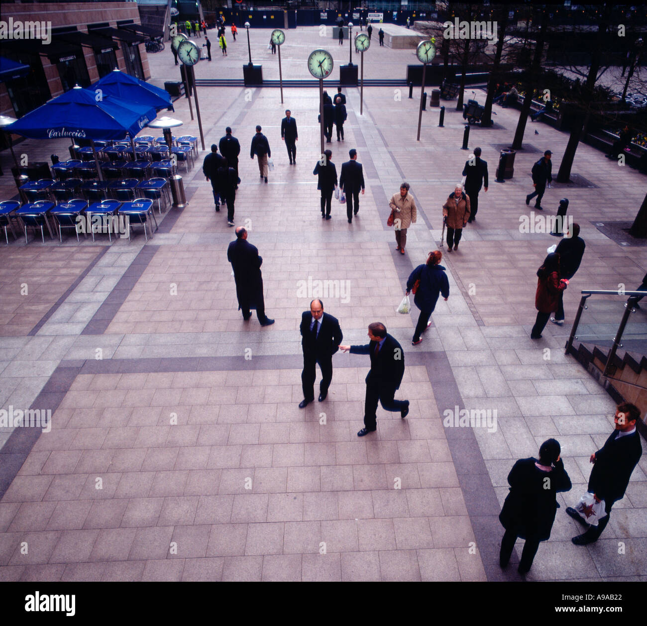 Office workers on concourse at Canary Wharf London UK Britain England United Kingdom Stock Photo