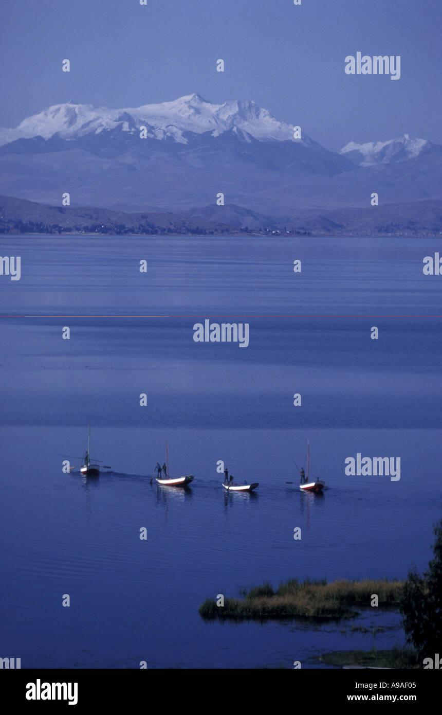 BOLIVIA Lake Titicaca fishing boats off Suriqui Island Cordillera Real in background - Stock Image