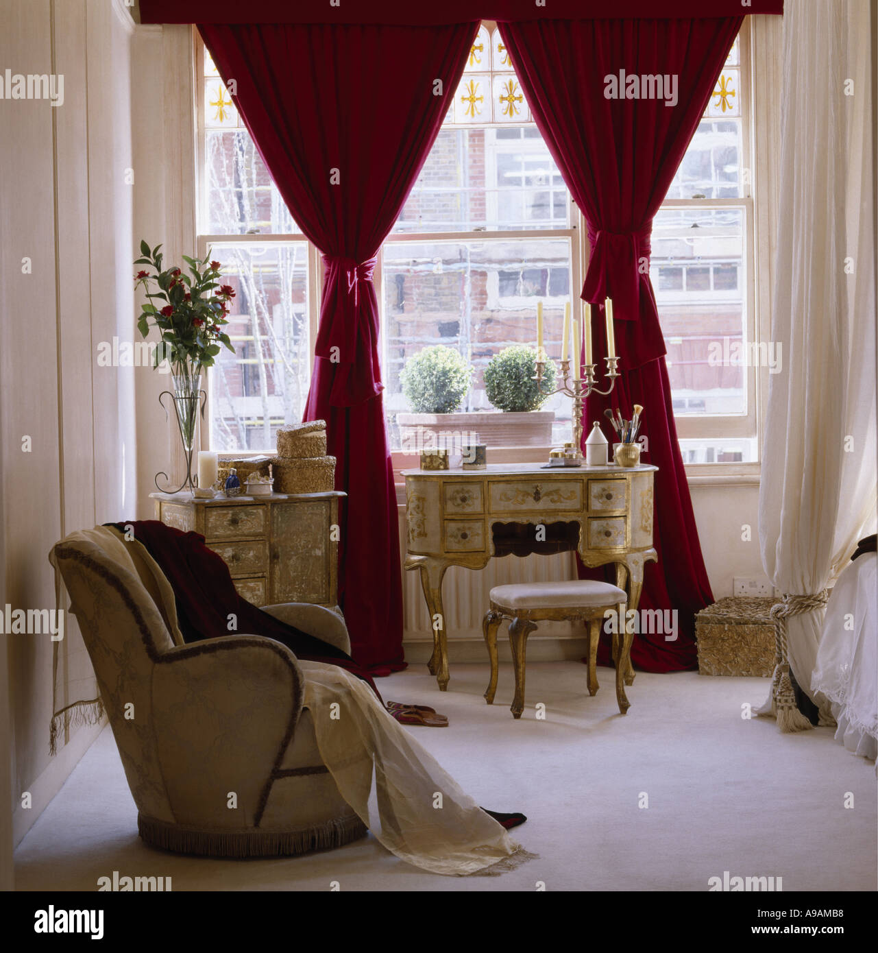 Bedroom With Red Curtains Stock Photo Alamy