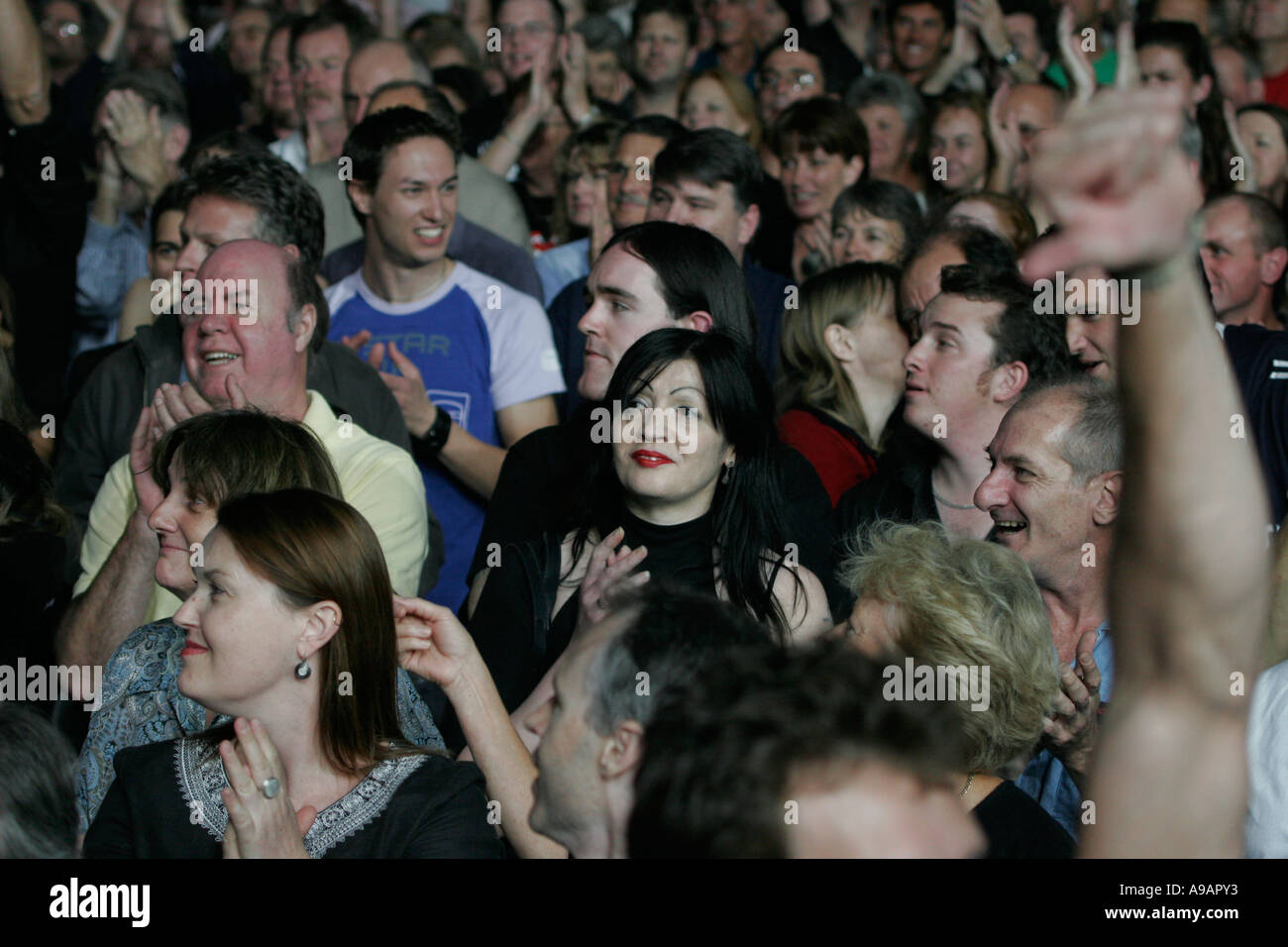 Music lovers at concert - Stock Image