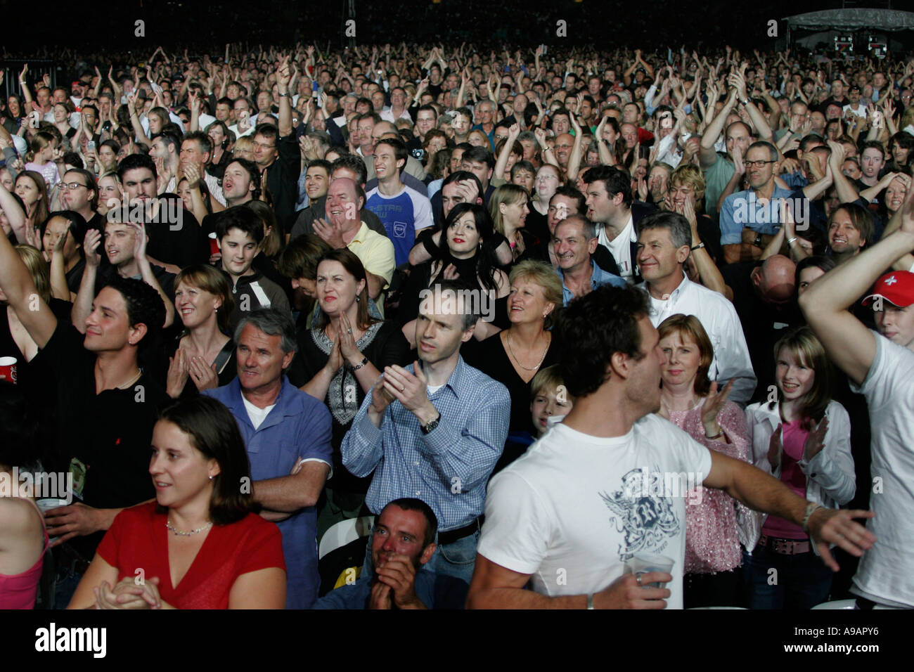 Fans celebrate the beginning of the Rolling Stones concert in Sydney April 2006 - Stock Image