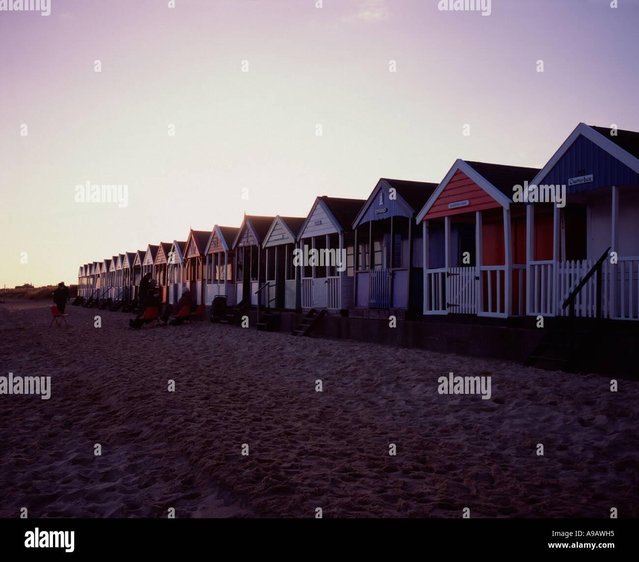Row of beach huts along the beach at Southwold, Suffolk, UK Stock Photo