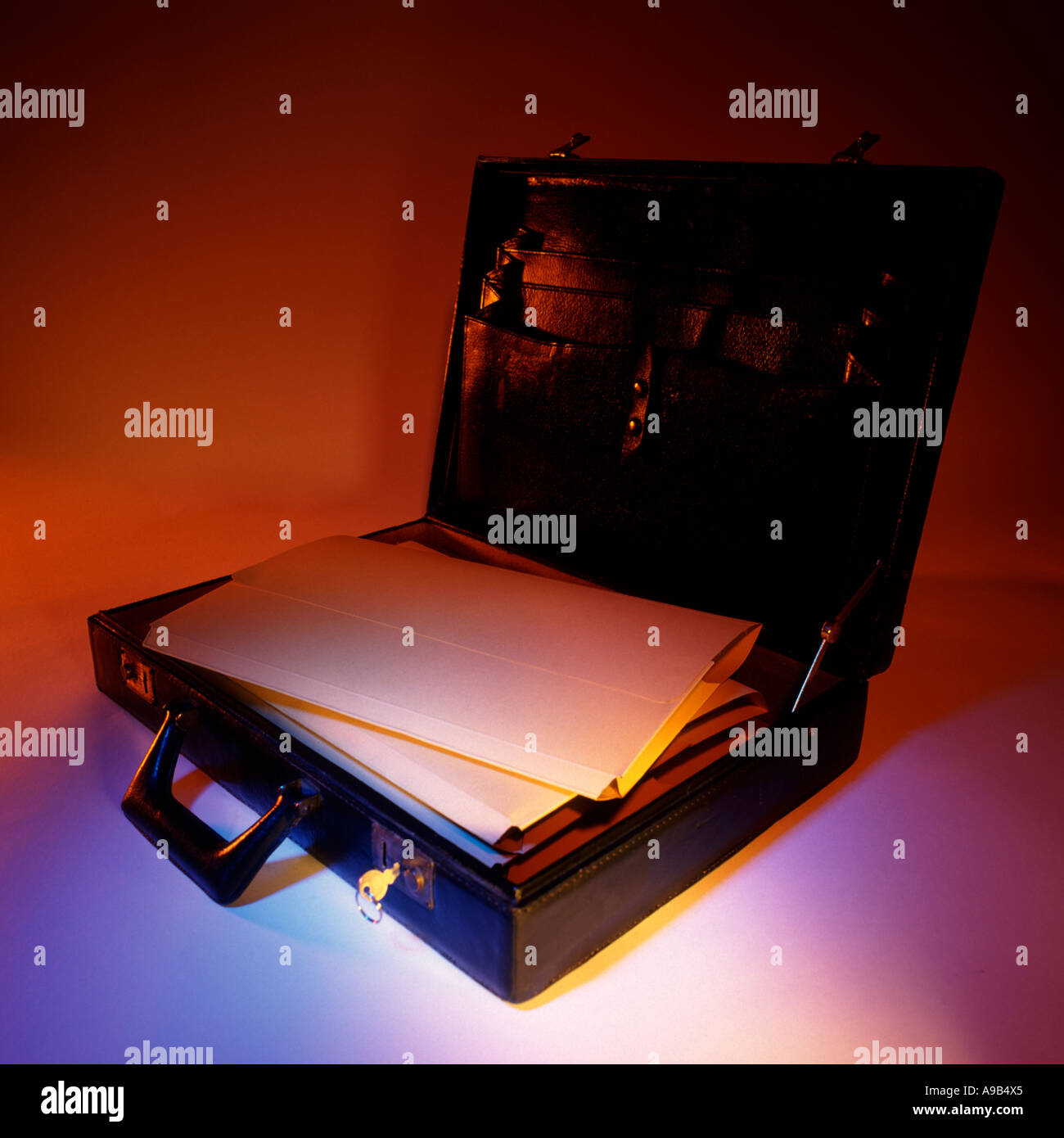 open briefcase - Stock Image