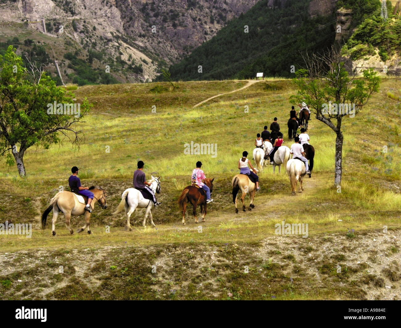 france alps provence haute alpes mont dauphin party of young people riding  - Stock Image