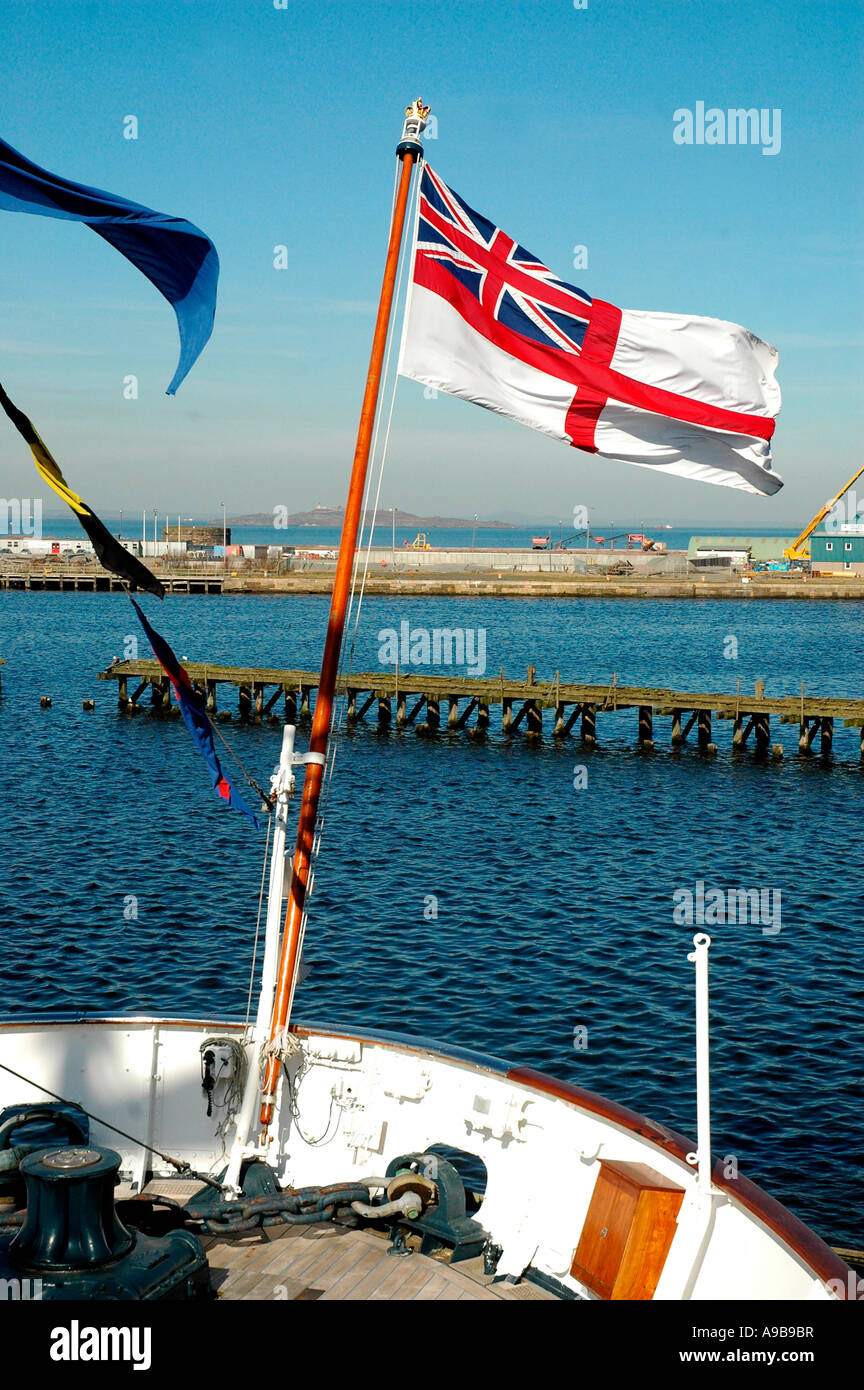 White Ensign flag flying from the Royal Yacht Britannia,Ocean Quay,Firth of Forth,Edinburgh,Scotland,United Kingdom - Stock Image