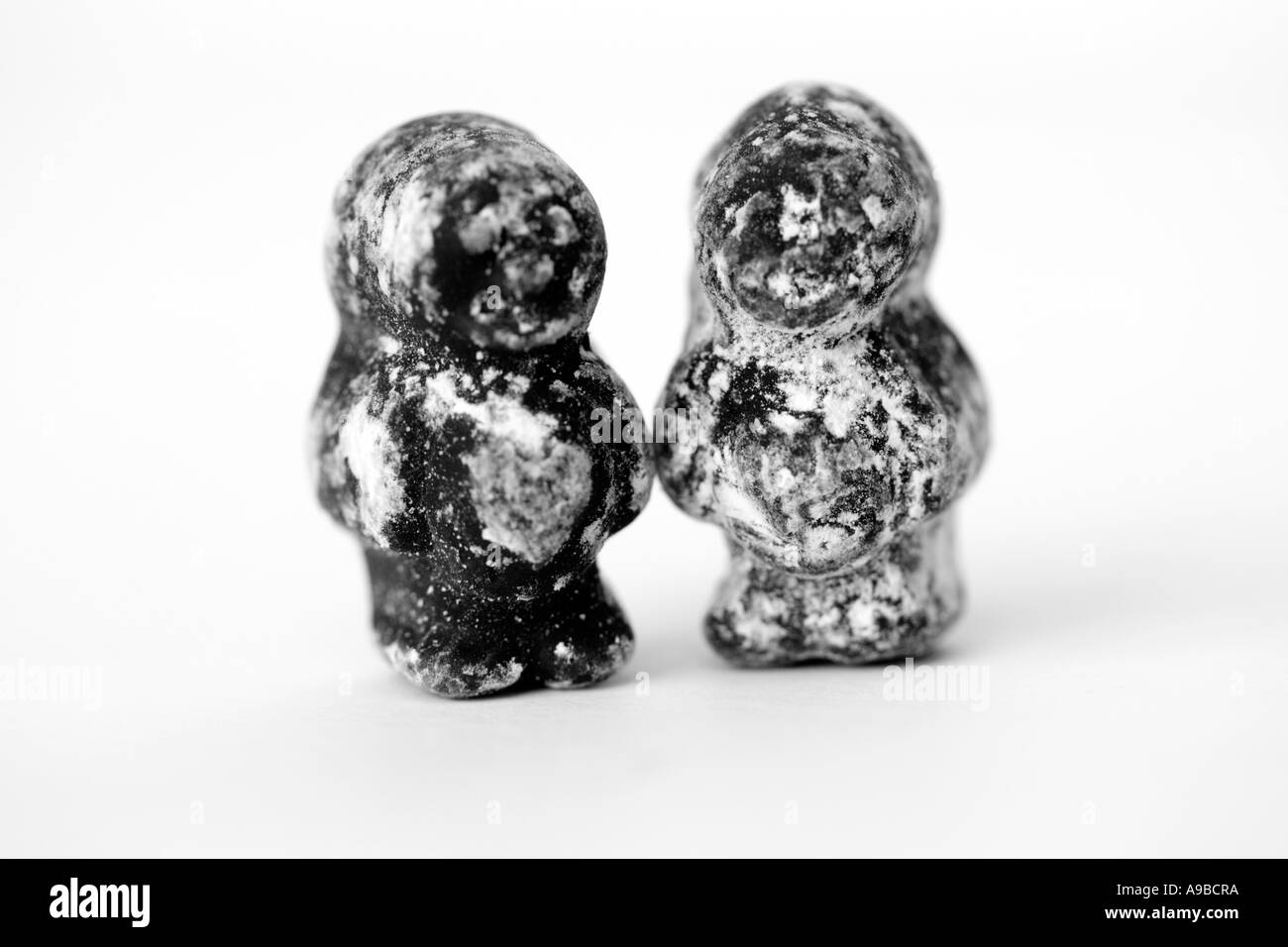 Two black jelly babies - Stock Image