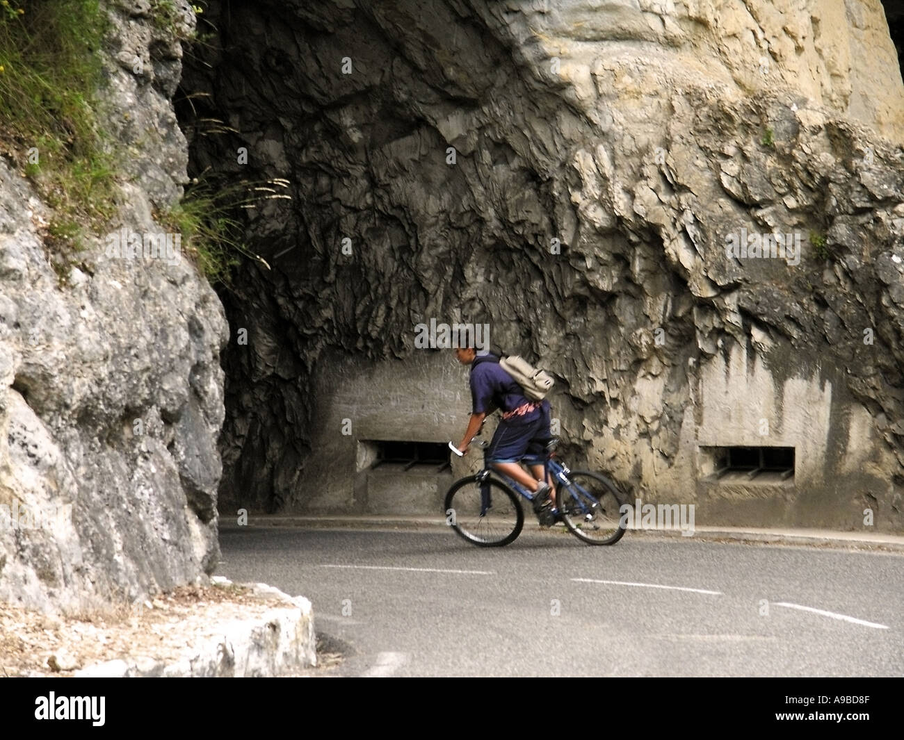 france teenage boy on bicycle cycling into tunnel - Stock Image