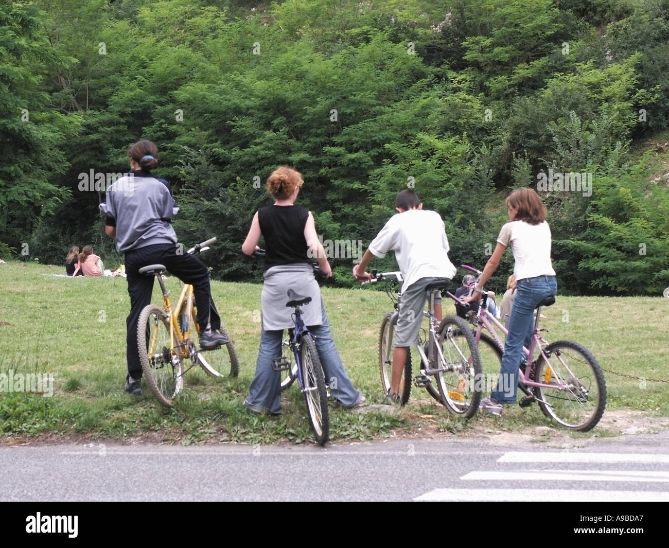 france group of french teenagers on bicycles - Stock Image