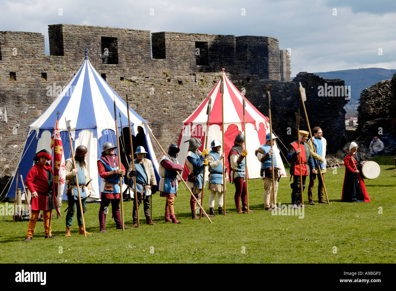 The Company of Chivalry reenactment of medieval life in the year 1370 at Caerphilly Castle South Wales UK - Stock Image