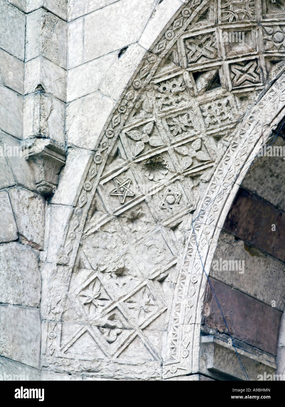 detail of carving on arch above entrance, Bab al-Futuh, Cairo, Egypt - Stock Image