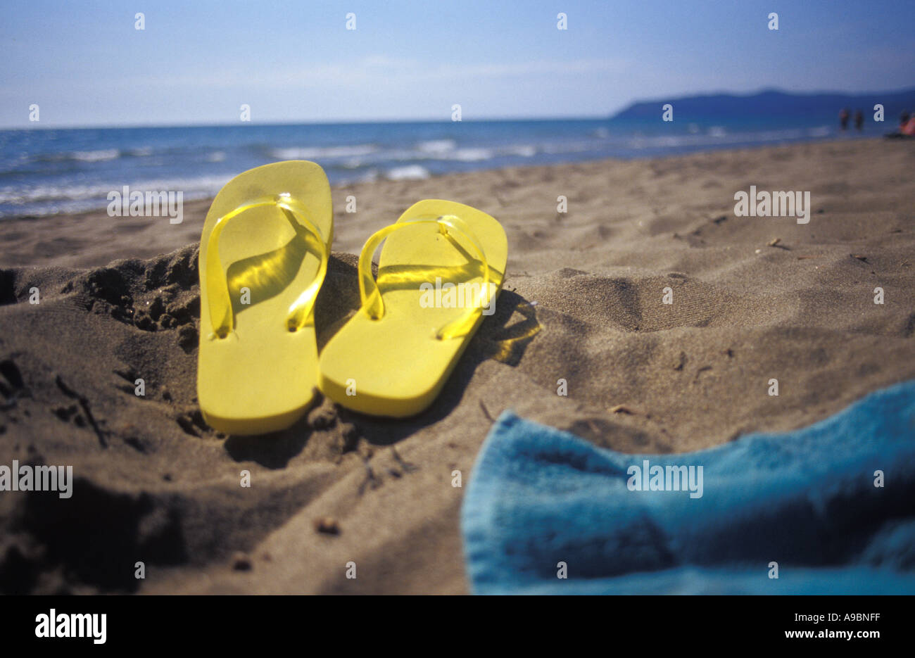 Flip flops on sand at beach - Stock Image