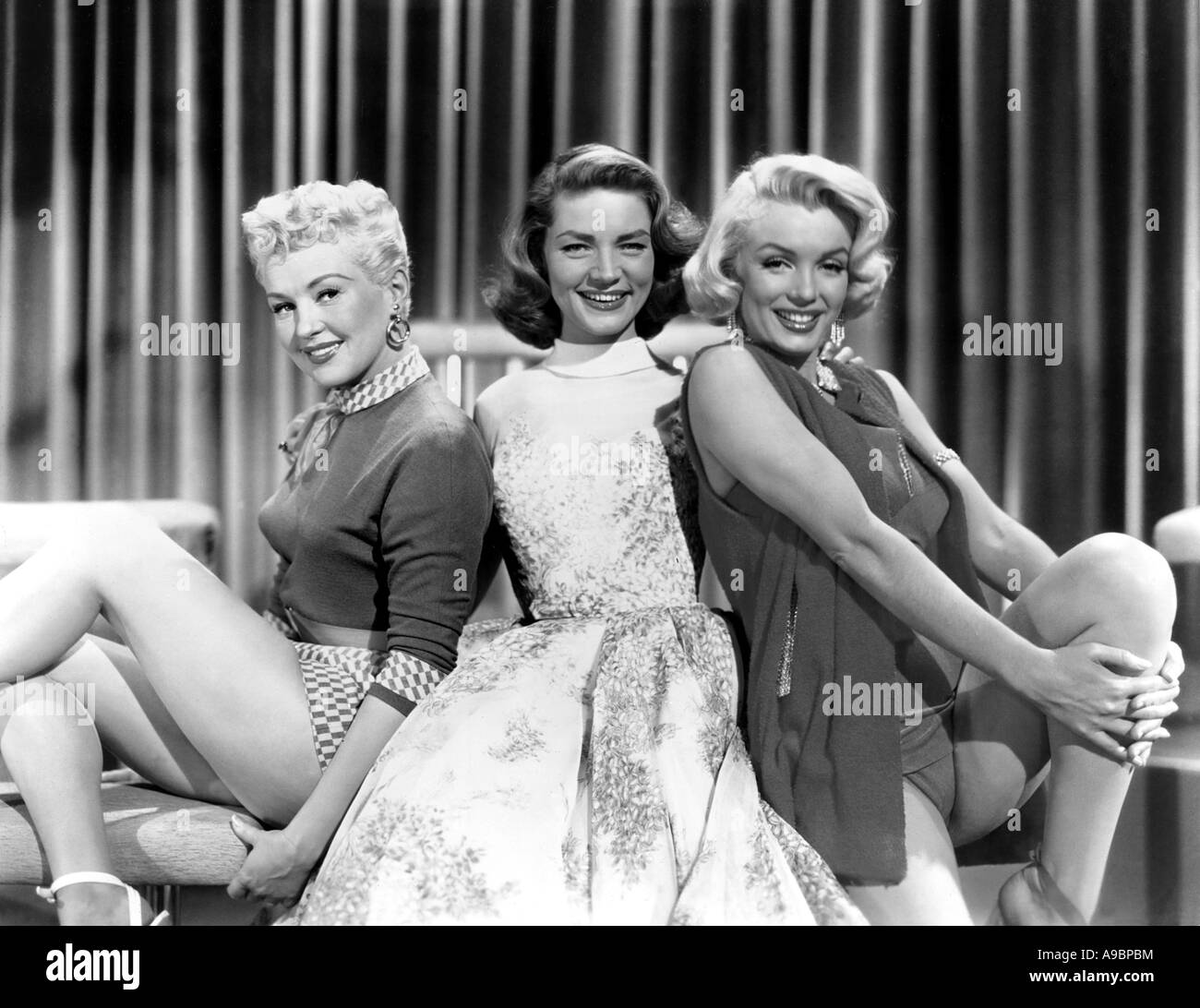 HOW TO MARRY A MILLIONAIRE  - 1953 TCF film with from l: Betty Grable, Lauren Bacall and Marilyn Monroe - Stock Image
