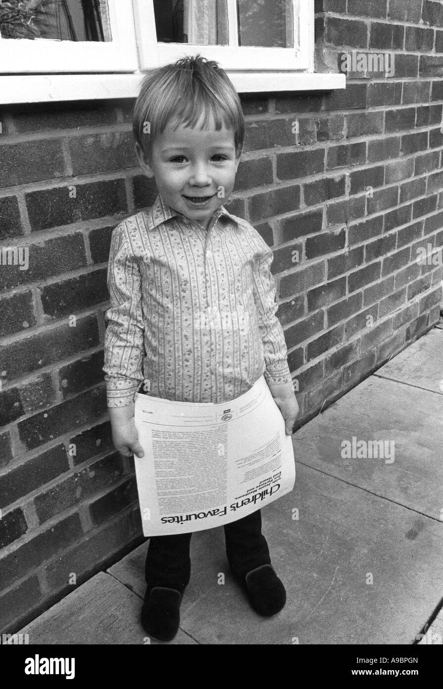 BOY WITH RECORD SLEEVE - Stock Image