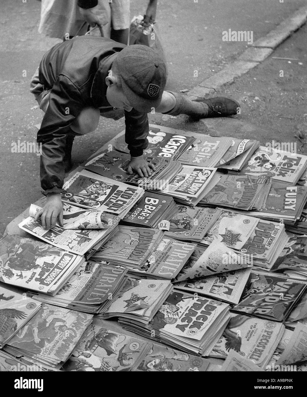 LONDON BOY WITH COMICS about 1950 - Stock Image