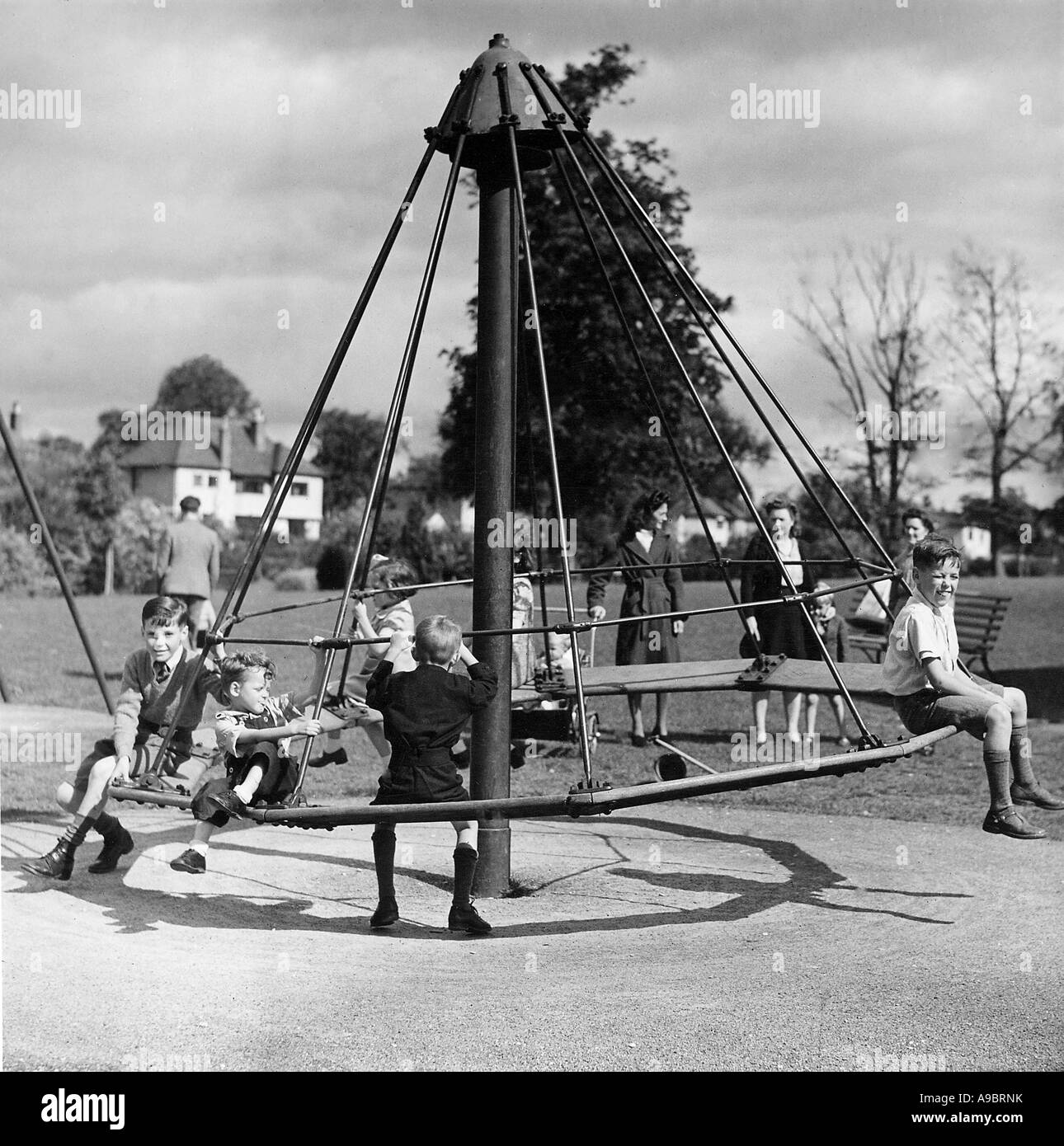 CHILDREN ON A ROUNDABOUT in 1943 - they were evacuated from London during the war - Stock Image
