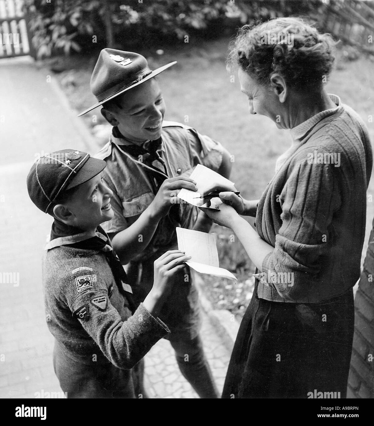 LONDON SCOUT and Cub  have their  Bob a Job cards signed by householder about 1950 - Stock Image