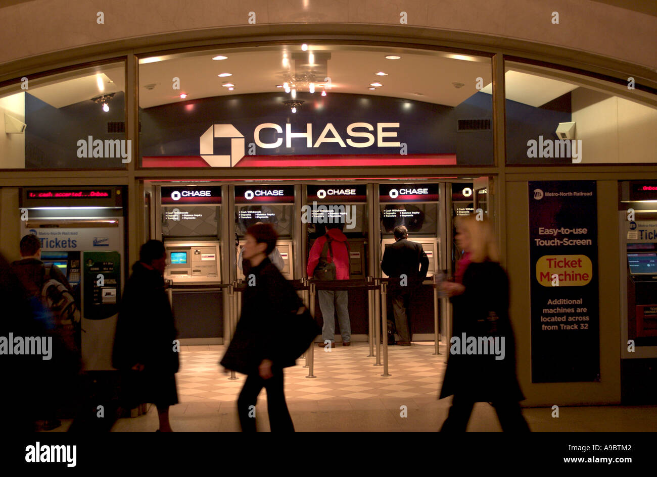 Early morning commuters use an automated branch of Chase