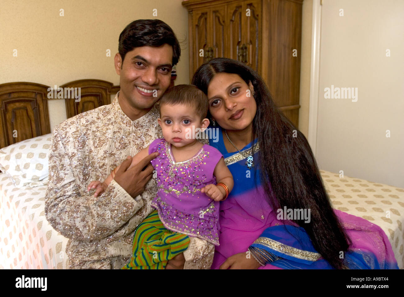Young bangladeshi american couple with their baby during the holiday of eid in brooklyn new york
